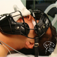 Patient spine surgery lying face up protecting his face with baseball Catcher.